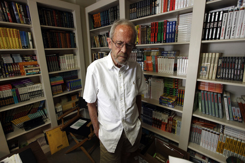 FILE - In this Sept. 17, 2012 file photo, author Elmore Leonard, 86, stands in his Bloomfield Township, Mich., home. Leonard, a former adman who later in life became one of America's foremost crime writers, has died. He was 87. His researcher says he passed away Tuesday morning, Aug. 20, 2013 from complications from a stroke. (AP Photo/Paul Sancya)