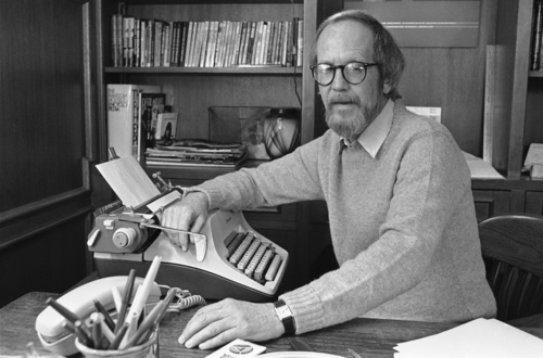 FILE - In this March 31, 1983 file photo, writer Elmore Leonard sits by his typewriter at his home in Birmingham, Mich. Leonard, a former adman who later in life became one of America's foremost crime writers, has died. He was 87. His researcher says he passed away Tuesday morning, Aug. 20, 2013 from complications from a stroke. (AP Photo/Rob Kozloff)