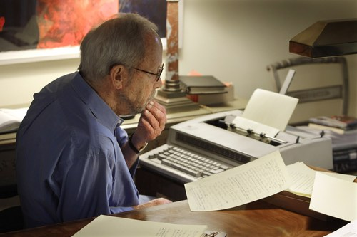 FILE - In this Sept. 28, 2010 file photo, author Elmore Leonard works on a manuscript at his home in Bloomfield Township, Mich. Leonard, the best-selling chronicler of schemers, clever conmen and casual killers, has died, announced Tuesday, Aug. 20, 2013. (AP Photo/Carlos Osorio)