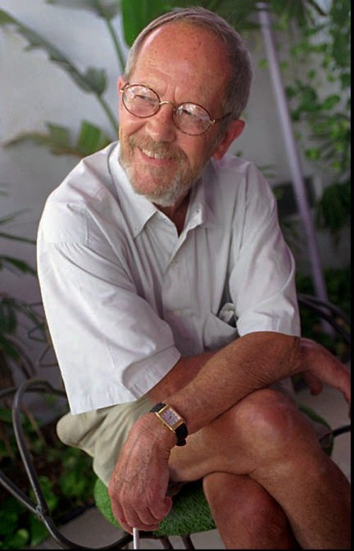 """FILE - In this June, 18, 1996 file photo, writer Elmore Leonard sits on the set of his latest book-turned movie, """"Pronto,"""" in Miami Beach, Fla. Leonard, a former adman who later in life became one of America's foremost crime writers, has died. He was 87. His researcher says he passed away Tuesday morning, Aug. 20, 2013 from complications from a stroke. (AP Photo/Marta Lavandier)"""