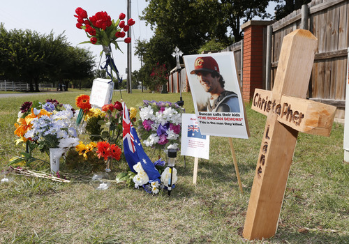A memorial to Christopher Lane is shown Tuesday, Aug. 20, 2013, along the road where he was shot and killed, in Duncan, Okla. Lane, an Australian who was on a baseball scholarship at East Central University in Ada, Okla., was in Duncan visiting his girlfriend, when he was shot and killed Friday, Aug. 16, 2013. (AP Photo/Sue Ogrocki)