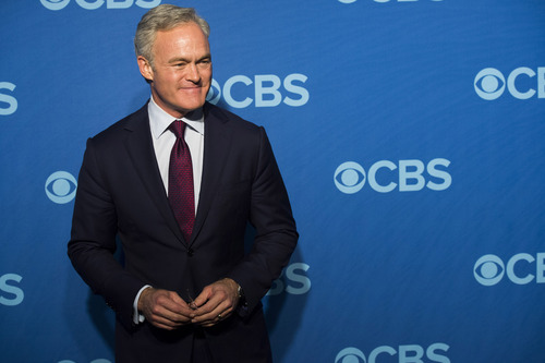 """FILE - This May 15, 2013 file photo shows Scott Pelley, anchor of """"CBS Evening News,""""  at the CBS Upfront in New York. (Photo by Charles Sykes/Invision/AP, File)"""