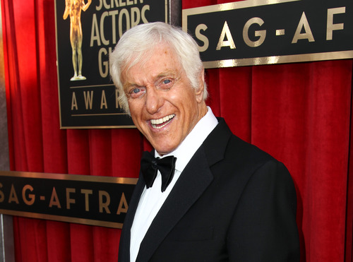 FILE - This Jan. 27, 2013 file photo shows actor Dick Van Dyke at the 19th Annual Screen Actors Guild Awards at the Shrine Auditorium in Los Angeles.  Van Dyke is fine after his Jaguar caught fire while he was driving on a Los Angeles freeway. California Highway Patrol officer Saul Gomez said Monday, Aug. 19, 2013, that witnesses reported the fire just before 2 p.m. and said that an elderly man was slumped over behind the wheel of the flaming car.  (Photo by Matt Sayles/Invision/AP, file)