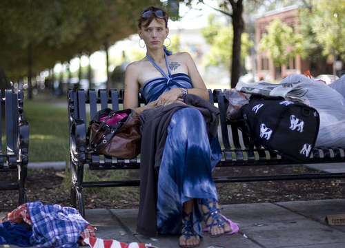 Keith Johnson | The Salt Lake Tribune  Karren Cardenas, surrounded by her belongings, sits on a bench at Pioneer Park in Salt Lake City, August 19, 2013. Karren is homeless and trying to get off the street.