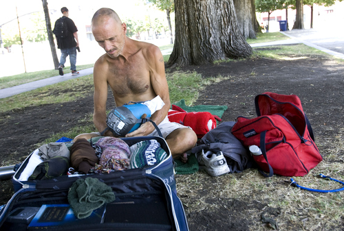 Keith Johnson | The Salt Lake Tribune  Kevin Tetreault organizes his belongings at Pioneer Park in Salt Lake City, August 19, 2013. Kevin is one of the many homeless that populate Pioneer Park during the day and often at night.