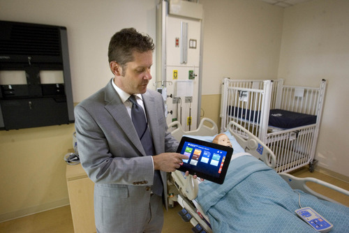 Paul Fraughton  |   The Salt Lake Tribune Dr. Wesley Valdes shows off a video tablet designed for use inside a patient's room. The patient can access different types of media such as movies, video games, television etc., as well as call the nurse.  Tuesday, August 20, 2013