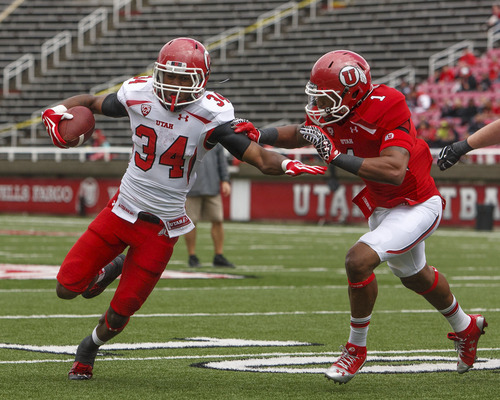 Trent Nelson  |  The Salt Lake Tribune James Poole (34) runs for the end zone during the University of Utah's Red-White Spring football game, Saturday April 20, 2013 in Salt Lake City. At right is Keith McGill