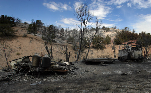 Rick Egan  | The Salt Lake Tribune   A trailer home and horse trailer, destroyed by the fire in Terra, Utah, Saturday, August 17, 2013.