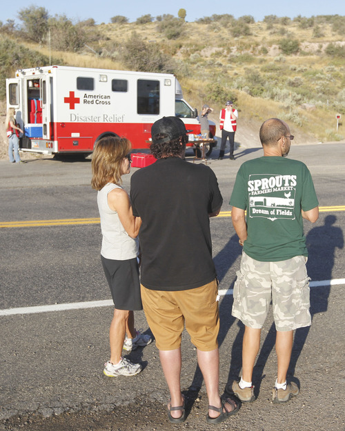 Al Hartmann  |  The Salt Lake Tribune Rockport Estates residents Susan Cronin, Andy Varner and Jerry Serra, wait on SR 32 Monday morning to go back to their subdivision community after being displaced for nearly a week from the Rockport 5 Fire.