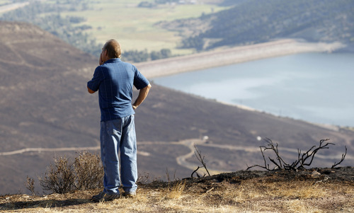Al Hartmann  |  The Salt Lake Tribune Rockport Estates ranch manager Alan Lindsley looks over the burned mountainside from the Rockport 5 Fire. Residents of the community were finally allowed to go back to their homes after nearly six days.