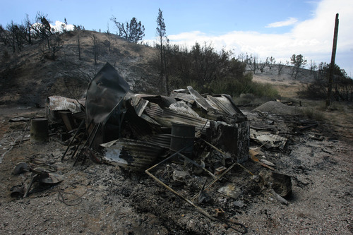 Rick Egan  | The Salt Lake Tribune   A structure that was burned to the ground in Terra, Utah, Saturday, August 17, 2013.