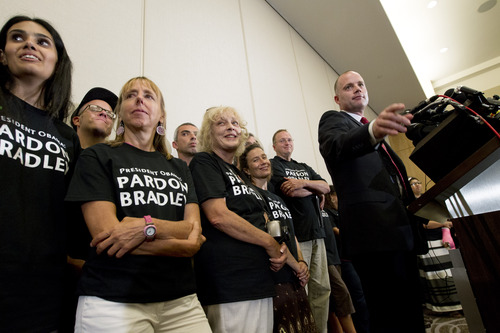 David Coombs, right, defense attorney for Army Pfc. Bradley Manning, speaks at a news conference in Hanover, Md., Wednesday, Aug. 21, 2013, after Manning was sentenced to 35 years in prison for leaking classified information to WikiLeaks.  (AP Photo/Jose Luis Magana)
