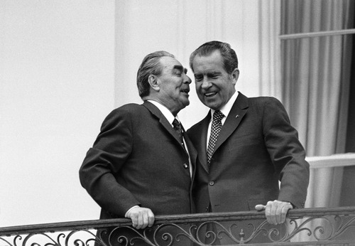 File  |  The Associated Press In this June 18,1973 file photo, Soviet leader Leonid I. Brezhnev, left, whispers in the ear of President Richard M. Nixon as the two leaders stand on a balcony at the White House in Washington. The meeting was the only summit ever recorded on an American presidential taping system. The last 340 hours of tapes from Nixon's White House were released Wednesday, along with more than 140,000 pages of text materials.