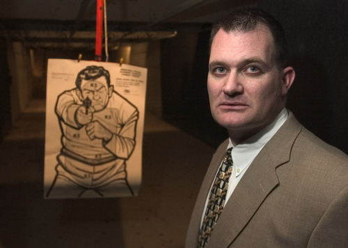 Rick Egan | Tribune file photo W. Clark Aposhian, seen in this 2005 photo, has been charged with four misdemeanors, including domestic violence. Aposhian has taught concealed-carry classes for legislators, public officials and the governor and hundreds of other Utahns, but a conviction could cost him his right to own guns.
