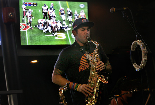 "Scott Sommerdorf   |  The Salt Lake Tribune Scott Schipper of ""Thrive"" plays while an NFL game is shown on one of the many TV screens in The Royal - a new bar that is run by the local band Royal Bliss, Friday, August 16, 2013."