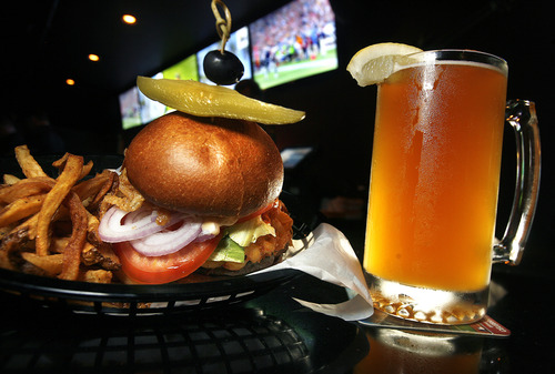 Scott Sommerdorf   |  The Salt Lake Tribune The Big D. Mac & Cheese Burger and a beer at The Royal - a new bar that is run by the local band Royal Bliss, Friday, August 16, 2013.