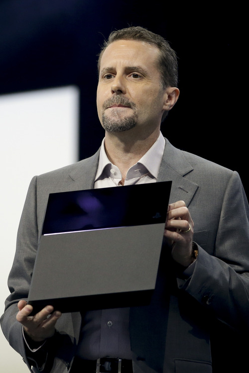 """FILE - In this June 10, 2013 file photo, Sony Computer Entertainment president and CEO Andrew House introduces the new PlayStation 4 at the Sony PlayStation E3 media briefing in Los Angeles. Twitch is coming to the PlayStation 4. The popular streaming video service that allows gamers to broadcast footage online was previously announced as a feature for Microsoft's Xbox One. Sony said Tuesday, Aug. 20, 2013, the service would also be available on the PS4, which adds a """"Share"""" button to its new controller.  (AP Photo/Jae C. Hong, File)"""