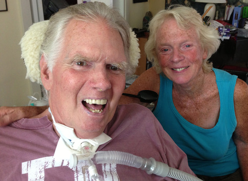 Photo courtesy of Sara Pearson. Brooke Hopkins smiles for the camera as he poses with his wife, Peggy Battin, after hearing from his hospice doctor on July 31, 2013. He died later that day.