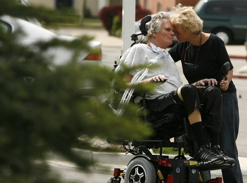 "In May 2009, Hopkins and Battin (r) steal some time for themselves outside the hospital, away from whirring and beeping machines. ""A domestic relationship that is so mutually enhancing is not something that everyone is lucky to have,"" said Battin.   Photo by Leah Hogsten/ The Salt Lake Tribune SLC 5/15/09"