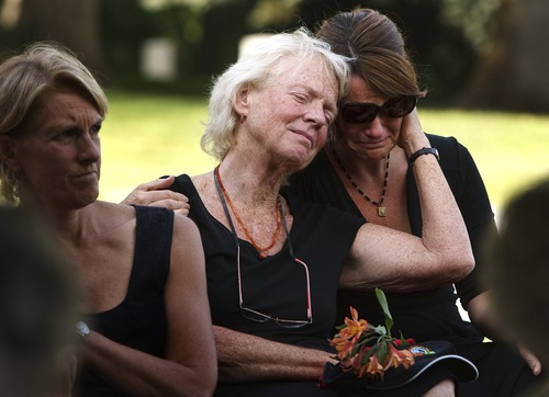 """Leah Hogsten   The Salt Lake Tribune  """"Everything my mom did, she did out of love for Brooke,"""" said Sara Pearson. Peggy Battin hugs her daughter, Sara Pearson, at the Salt Lake City Cemetery on Aug. 2, 2013, two days after Brooke Hopkins' death, as they listen to friends and family pay tribute to Brooke with funny, emotional stories about him and the moments they shared together."""
