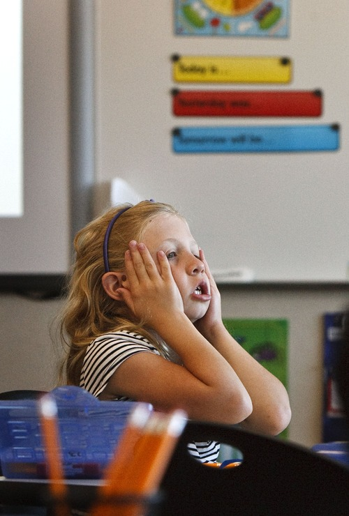 Leah Hogsten | The Salt Lake Tribune Neil Armstrong Academy first-grader Macenna Rolan had an attack of the sleepys while waiting for the first day of school to begin Wednesday, August 21, 2013.