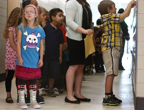 Leah Hogsten | The Salt Lake Tribune Neil Armstrong Academy first-grader Arikka Blair was a little teary-eyed waiting for direction from her teacher Candice Hind on the first day of school, Wednesday, August 21, 2013.