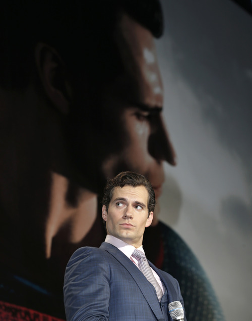 """Actor Henry Cavill poses for a photographers during the Japan premiere of his latest film """"Man of Steel"""" in Tokyo, Japan, Wednesday, Aug. 21, 2013. (AP Photo/Shizuo Kambayashi)"""