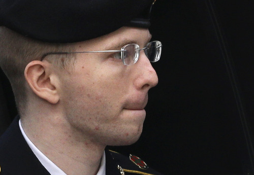 Army Pfc. Bradley Manning is escorted into a courthouse in Fort Meade, Md., Wednesday, Aug. 21, 2013, before a sentencing hearing in his court martial. The military judge overseeing Manning's trial said she will announce on Wednesday his sentence for giving reams of classified information to WikiLeaks. (AP Photo/Patrick Semansky)