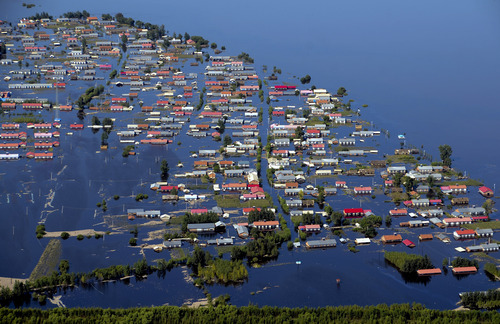 In this Tuesday, Aug. 20, 2013 aerial photo, houses are inundated by flood waters in Xiangyang town of Jiayin county in northeast China's Heilongjiang province. Heavy flooding in the extreme south and northeast has left more than 200 dead or missing in recent days. (AP Photo) CHINA OUT