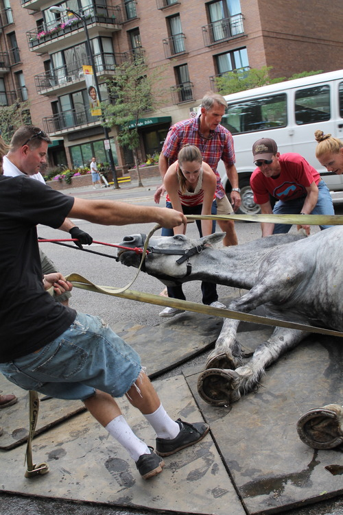 Courtesy of Jeremy Beckham Handlers attempt to move Jerry, a 13-year-old carriage horse, out of the roadway after he collapsed on Saturday near South Temple and State Street.