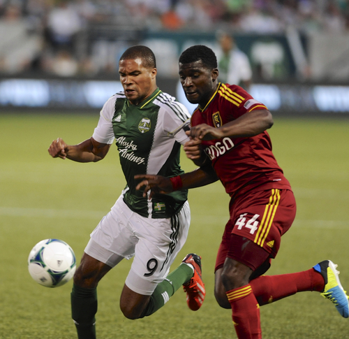 Portland Timbers' Ryan Johnson (9) battles against Real Salt Lake's Brandon McDonald (44) during the first half of an MLS Soccer game in Portland, Ore., Wednesday August 21, 2013.  (AP Photo/Greg Wahl-Stephens)