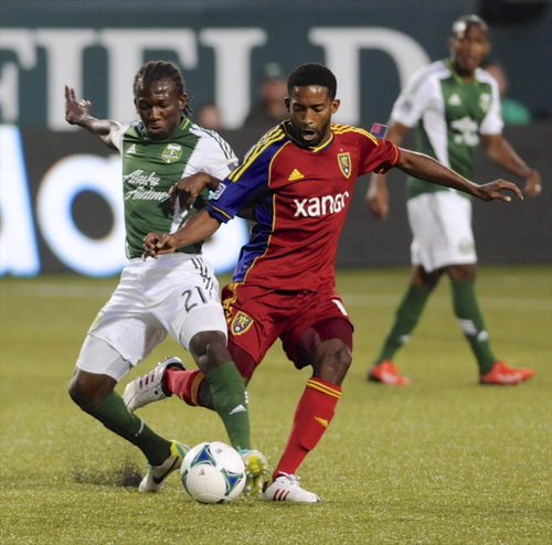 Portland Timbers' Diego Chara (21) battles against Real Salt Lake's Yordany Alvarez (14) during the first half of an MLS Soccer game in Portland, Ore., Wednesday Aug. 21, 2013.  (AP Photo/Greg Wahl-Stephens)