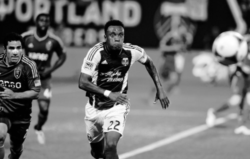 Portland Timbers' Rodney Wallace (22)  chases a ball against Real Salt Lake's Tony Beltran (2) during the first half of an MLS Soccer game in Portland, Ore., Wednesday August 21, 2013.  (AP Photo/Greg Wahl-Stephens)
