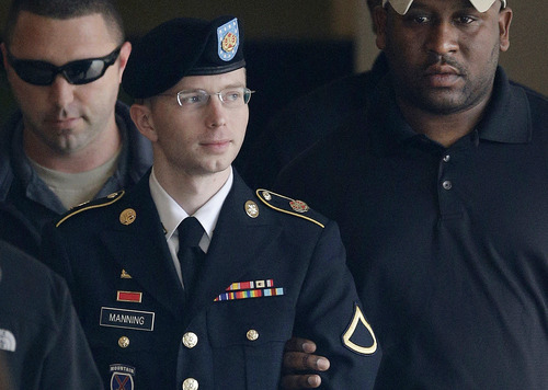 FILE - In this Tuesday, Aug. 20, 2013 file photo, Army Pfc. Bradley Manning is escorted to a security vehicle outside a courthouse in Fort Meade, Md., after a hearing in his court martial. Manning plans to live as a woman named Chelsea and wants to begin hormone therapy as soon as possible, the soldier said Thursday, Aug. 22, 2013, a day after he was sentenced to 35 years in prison for sending classified material to WikiLeaks. (AP Photo/Patrick Semansky, File)