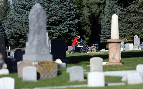 Francisco Kjolseth  |  The Salt Lake Tribune Adam Kubicki, a ground penetrating radar technician, pushes a 400 MHz antenna along a municipally owned section of the Salt Lake City Cemetery on Wednesday in search of famous Western gunslinger Jack Slade buried in 1864. Slade was famous for protecting stage coach routes between eastern and western U.S. and was also a drunk who was lynched for disturbing the peace in Montana, before being buried in the Avenues cemetery. A historian believes his grave is in a 16-by-16 foot plot in the Salt Lake City Cemetery, and he's attempting to dig up the body and move it to Slade's home in Illinois.