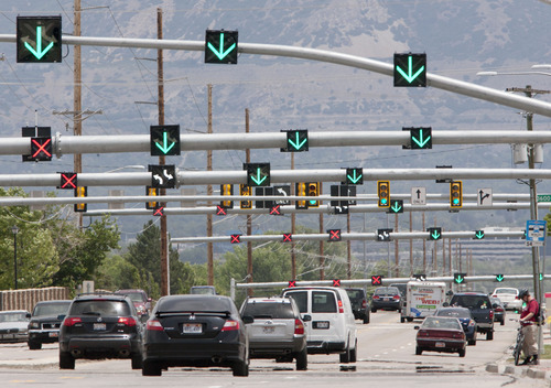 Steve Griffin | The Salt Lake Tribune Arrows point to the direction of traffic on first-of-their-kind-in-Utah 'flex lanes' on 5400 south in Taylorsville. State highway and police records indicate the experimental reversible lanes are as safe -- perhaps even more safe -- than regular, static lanes.