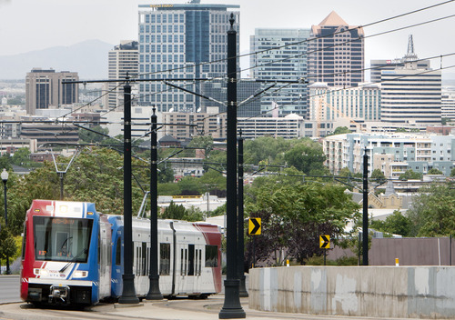 Steve Griffin | The Salt Lake Tribune  A UTA TRAX train climbs out of downtown Salt Lake City as it heads to the University of Utah in Salt Lake City, Utah Monday June 24, 2013. The Salt Lake Chamber and its Utah Transportation Coalition has released a study on the impact of investing in Utah's transportation system.