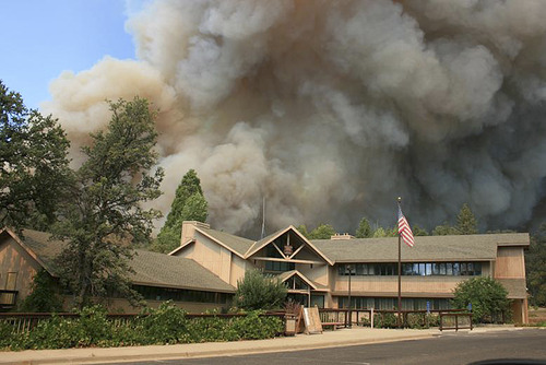 U.S. Forest Service  |  The Associated Press In this undated photo provided by the U.S. Forest Service, the Rim Fire burns near Groveland Ranger Station in Groveland, Calif. The wildfire outside Yosemite National Park — one of more than 50 major brush blazes burning across the western U.S. — more than tripled in size overnight and still threatens about 2,500 homes, hotels and camp buildings. Fire officials said the blaze burning in remote, steep terrain had grown to more than 84 square miles and was only 2 percent contained on Thursday, down from 5 percent a day earlier. (AP Photo/U.S. Forest Service)