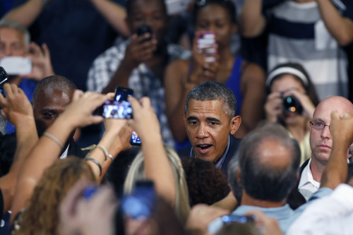 President Barack Obama is greeted as he arrives at the University at Buffalo, Thursday, Aug. 22, 2013, in Buffalo, N.Y., where he began his two day bus tour to speak about college financial aid. (AP Photo/Keith Srakocic)