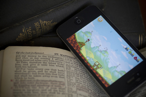 Jeremy Harmon  |  The Salt Lake Tribune  Anecdotally, more and more people are playing with their mobile devices during religious services. But are they using the devices to follow along with the sermon, or are they just using the time to shoot birds at pigs?