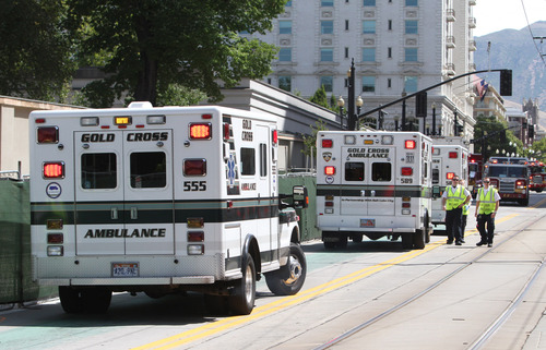 Rick Egan  |  The Salt Lake Tribune  Ambulances line up on South Temple after toxic fumes were accidentally released in the South Visitors Center at Temple Square, Thursday, August 22, 2013.