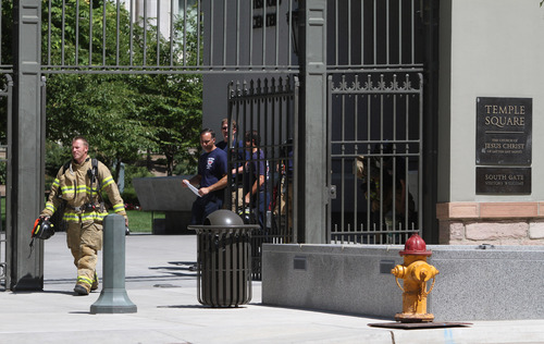 Rick Egan  | The Salt Lake Tribune   Firefighters exit Temple Square after checking out the accidental release of toxic fumes in the South Visitors Center at Temple Square, Thursday, August 22, 2013.