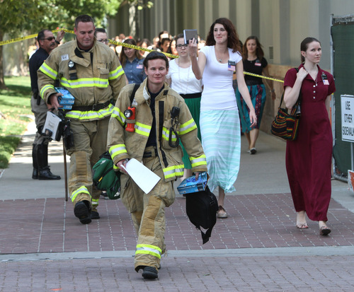 Rick Egan  |  The Salt Lake Tribune Sister missionaries are evacuated from Temple Square to be checked out by emergency personnel after toxic fumes were detected in the South Visitors Center at Temple Square on Thursday.