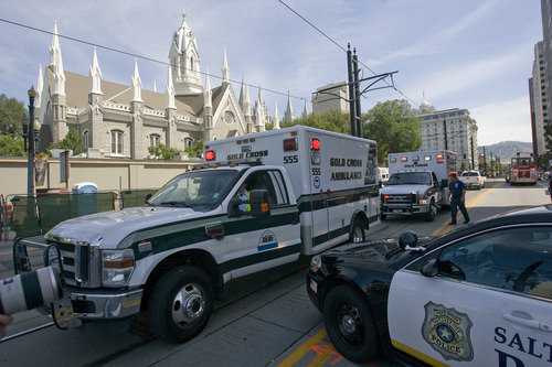 Rick Egan  |  The Salt Lake Tribune  Emergency vehicles line up on South Temple after toxic fumes were accidentally released in the South Visitors Center at Temple Square, Thursday, August 22, 2013.