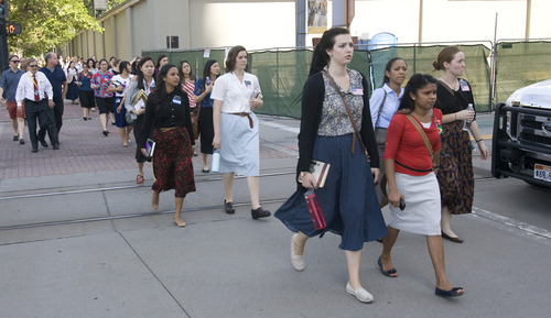 Rick Egan  |  The Salt Lake Tribune  LDS Church sister missionaries are evacuated from Temple Square to be checked out by emergency personnel after toxic fumes were accidentally released in the South Visitors Center at Temple Square, Thursday, August 22, 2013.