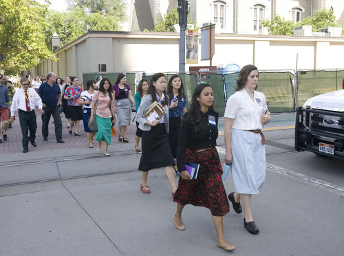 Rick Egan  |  The Salt Lake Tribune  LDS Church missionaries are evacuated from Temple Square to be checked out by emergency personnel after toxic fumes were accidentally released in the South Visitors Center at Temple Square, Thursday, August 22, 2013.