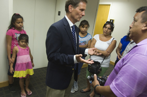 Keith Johnson  |  The Salt Lake Tribune Rep. Chris Stewart, R-Utah, center, talks to Tony Yapias about immigration reform while Catalina Tenorio, right, facing, and her daughters, from left: Katya, 8, Amy, 5, and Natalie, 11, listen during a Thursday open house at Stewart's office in Salt Lake City.