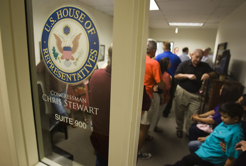 Keith Johnson | The Salt Lake Tribune  People pack the Salt Lake City office of Rep. Chris Stewart, R-Utah during an open house, August 22, 2013.