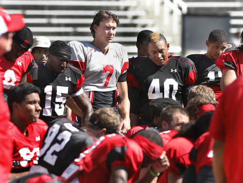 Scott Sommerdorf   |  The Salt Lake Tribune DB Michael Walker, No. 15, QB Travis Wilson, No. 7, LB Jacoby Hale, No. 40, and other Utes listen to coach Whittingham after Utah football practice, Wednesday, Aug. 14, 2013.
