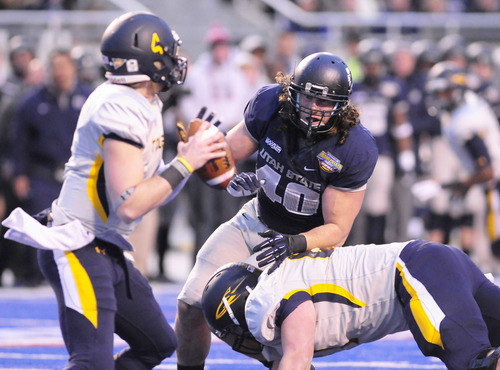 | Courtesy Utah State Athletics Utah State defensive end Connor Williams rushes the passer during the Idaho Potato Bowl last season. Now a senior, Williams is one of the Aggies' top leaders on defense.